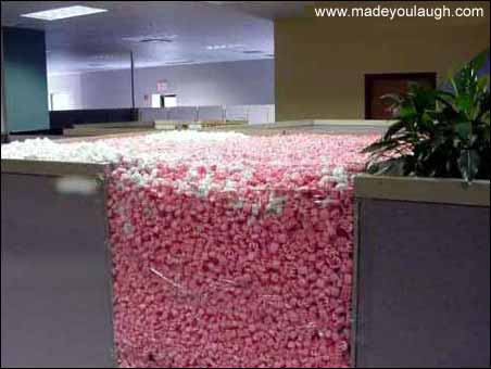 funny packing peanuts in cubicle office prank