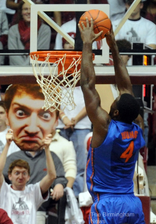 funny large cut out face at basketball game