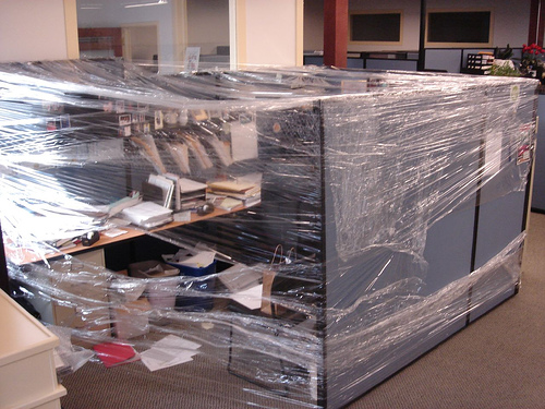 funny office pranks - shrink wrap cubicle
