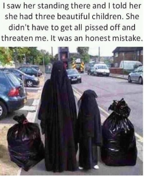 funny arab woman dressed in black next to garbage bags