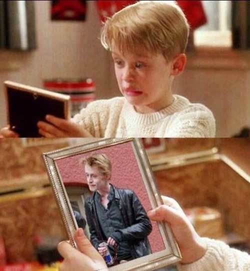 funny photo mccauley caulkin home alone looking at picture of himself in future