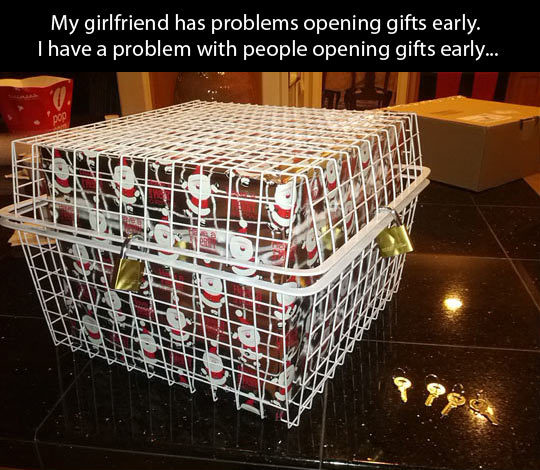 funny caption picture christmas presents locked up so girlfriend can't peek