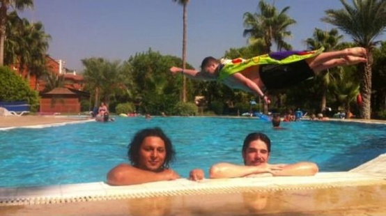 funny super photo bomber jumping in pool exact right time