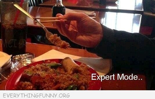 funny expert mode using chopsticks to pick up fork and eat