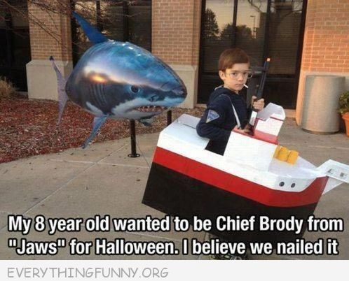 funny caption boy goes as jaws with balloon shark