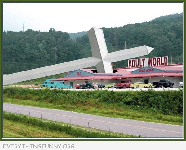 funny huge cross falls on adult store