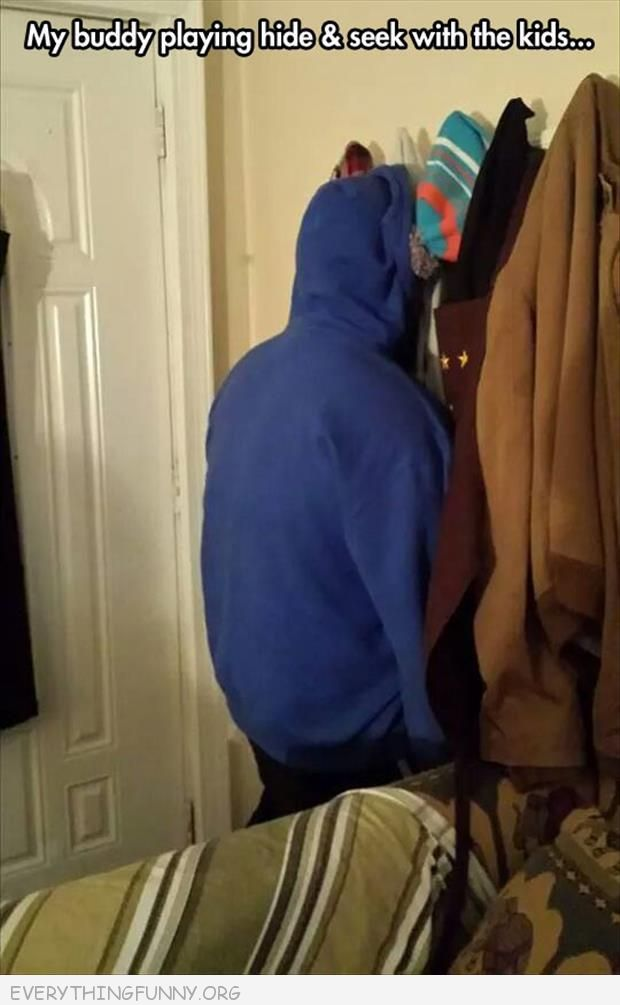 funny caption friend playing hide and seek with kids pretending to be haning sweatshirt