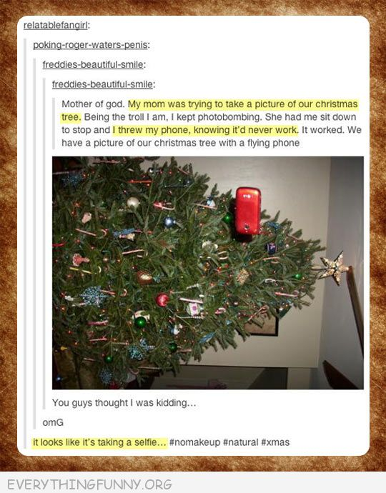 funny flying phone at christmas tree photobomb