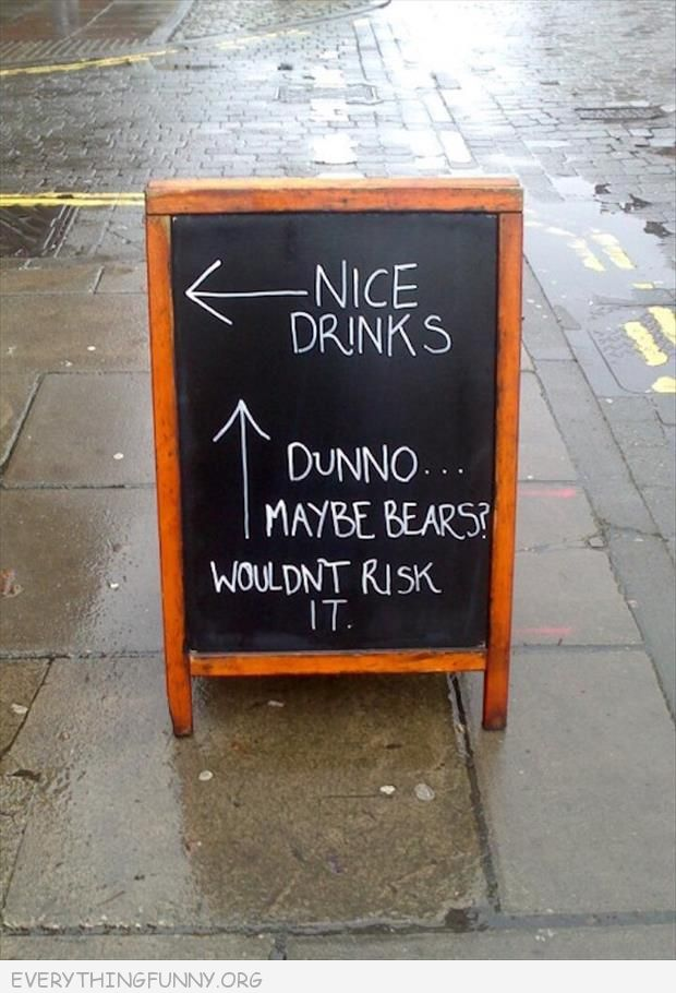 funny billboard sign nice drinks to the left up ahead dunno maybe bears don't risk it