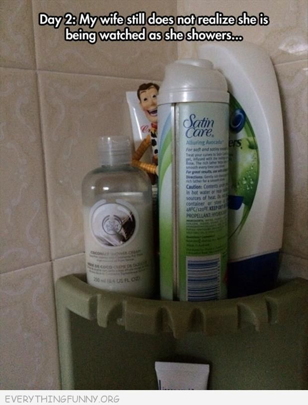 funny wife still doesnt' know someone watching her in shower woody doll figure hidden behind shampoo