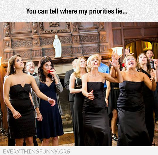 funny caption girl drinks wine while others try and catch bouquet can tell where my priorities lie