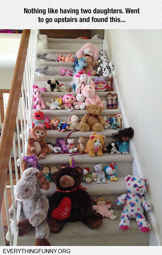 funny caption two little daughters fill stairs with toys