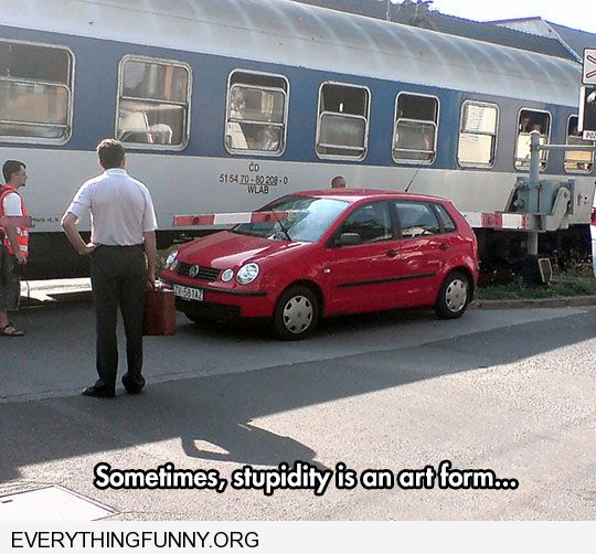 funny little car with train gate going through it sometimes stupidity is an art form