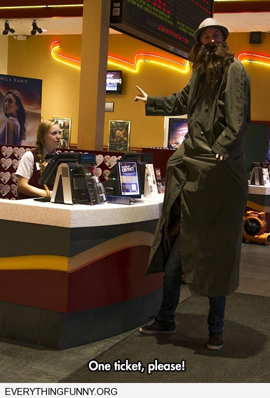 funny two kids actually on shoulders with long over coat pretending to be adult to buy r rated movie ticket