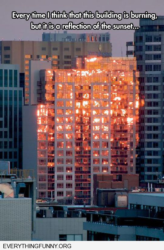 funny caption building looks like it is on fire just sun reflection
