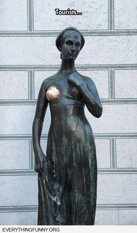 funny tourists wipe copper statue boob breast clean by constantly rubbing it