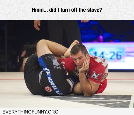 funny caption wrestler looks like pondering in perfectly timed photo hmmm did i turn off the stove