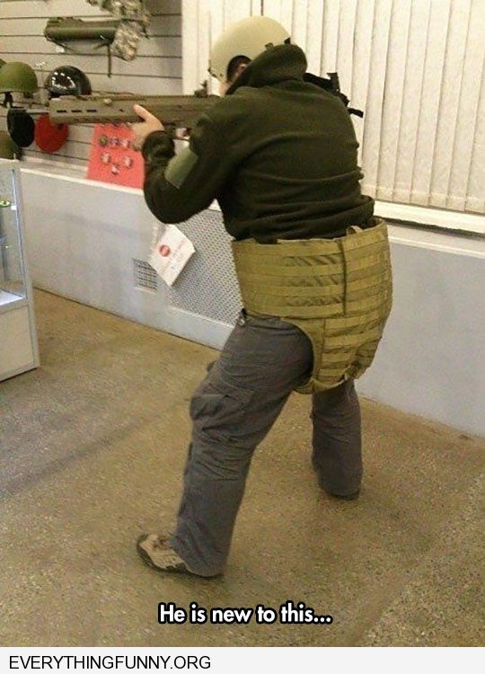 funny capton man wears bullet proof vest over crotch instead of chest he is new to this