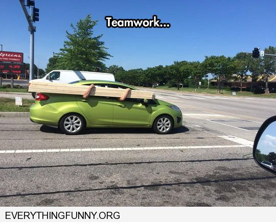 funny caption teamwork two men hold boards front seat back seat out window