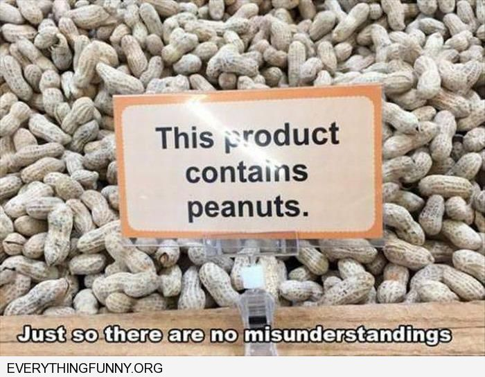 funny caption peanuts has a sign that says this product contains peanuts  just so there are no misunderstandngs
