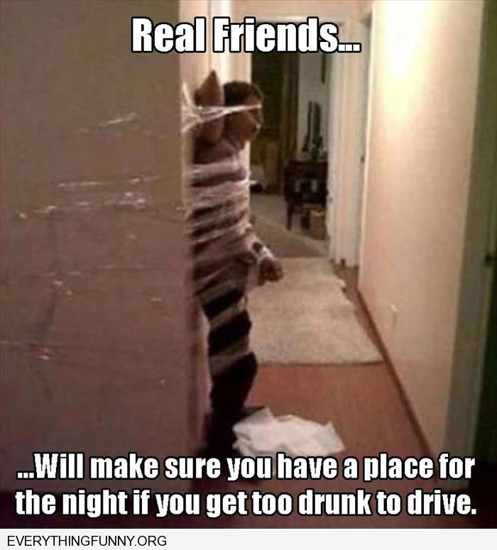 funny captions friends taped drunk friend to wall to keep him standing while passed out