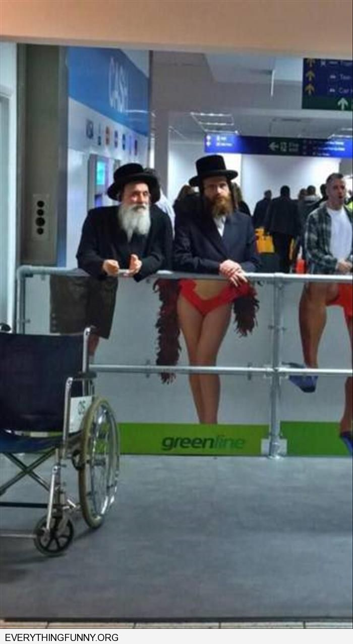 jewish men unknowingly stand behind sexy ad