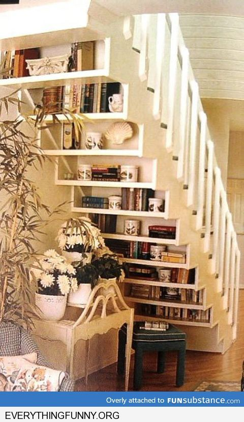 creative way to use bottom of staircase under shelves