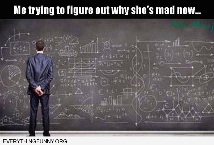 funny man standing in front of complicated equation on blackboard trying to figure out what she is mad about