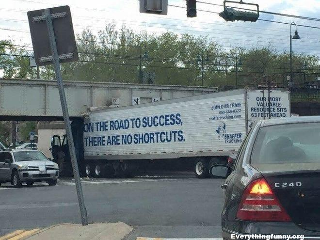 funny photo truck stuck under clearance on the road to success there are no shortcuts