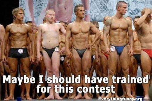 funny picture white guy not in shape with tanned body builders maybe I should have trained for this contest