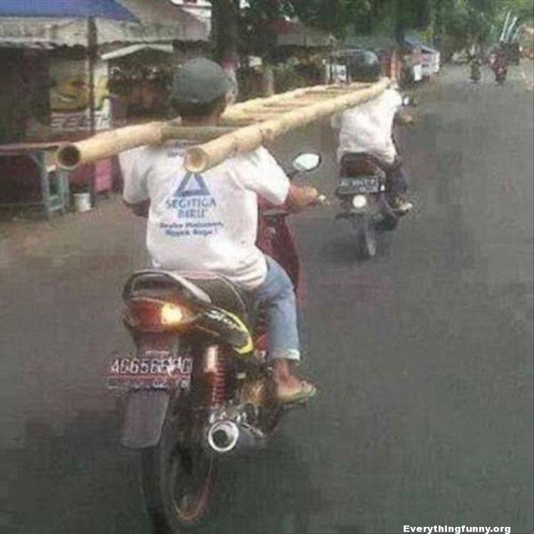funny photo men riding on motorcycles with ladder around both necks