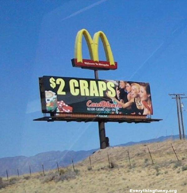 funny billboard sign mcdonalds sign and $2 craps sign underneath it