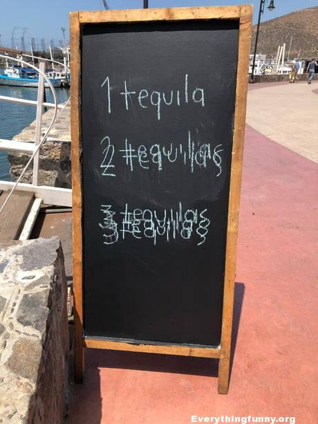 funny billboard 1 tequila 2 tequilas 3 tequilas drawn in chalk like people are drunk funny bar sign