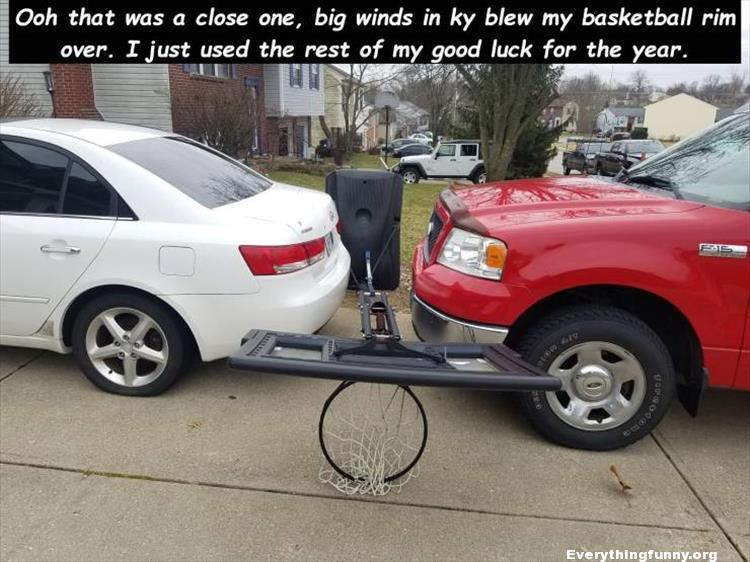 funny picture basketball hoop falls down right in between two cars due to strong wins just misses both cars