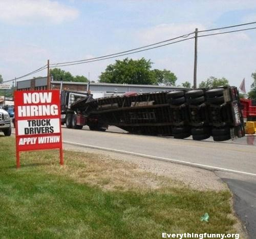 funny picture funny sign truck rolls over sign right next to it says now hiring truck drivers apply within