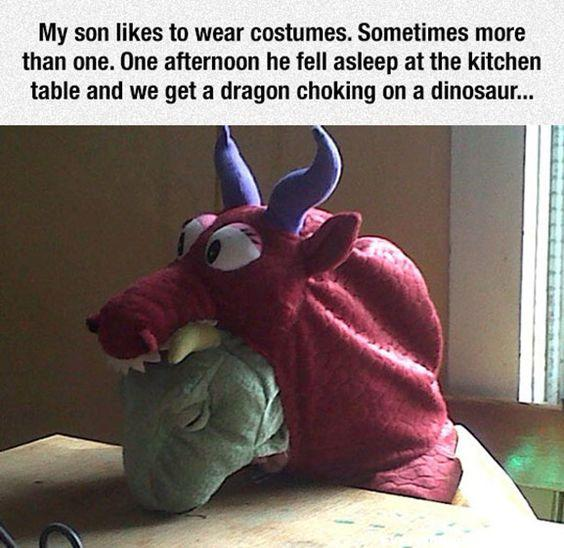 funny caption, funny kids, funny costume, my son like to wear costumes sometimes more than one he fell asleep at kitchen table and we get a dragon choking on a dinosaur