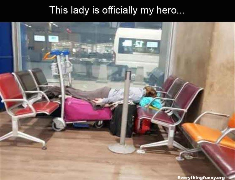 funny caption woman uses luggage cart to make herself a bed at the airport between two rows of chairs