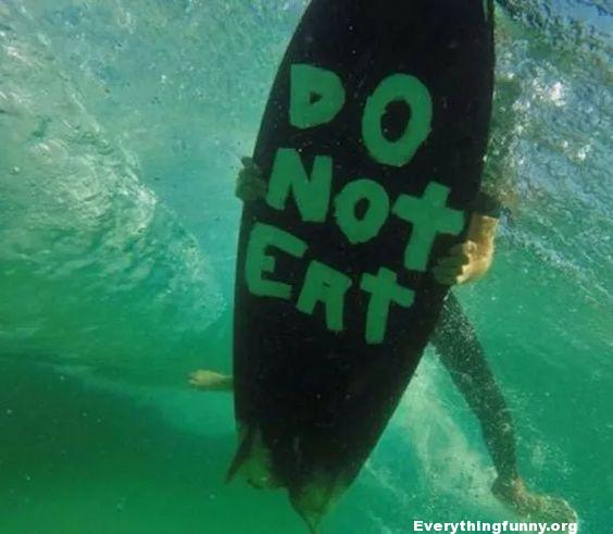 funny pictures, funny photos funny do not eat sign on bottom of surfboard for sharks
